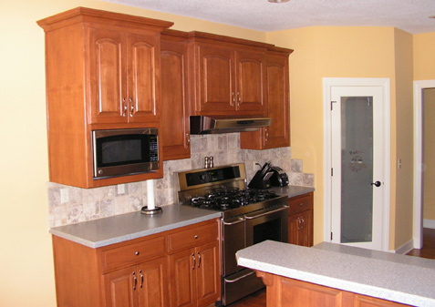Custom Birch Kitchen Cabinets Eyebrow Arch Upper Raised Panel Doors Solid Surface Acrylic Countertops