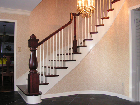 Curved Staircase With Custom Turned Newel Post